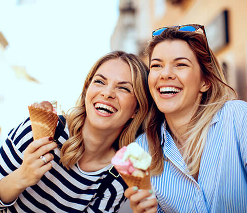 two sisters enjoying ice cream